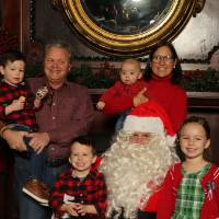Family of six with Santa Claus